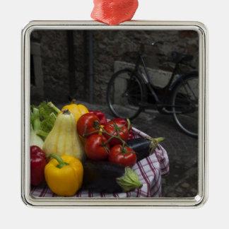 Italy, Brescia Province, Gargnano. Table with 2 Metal Ornament