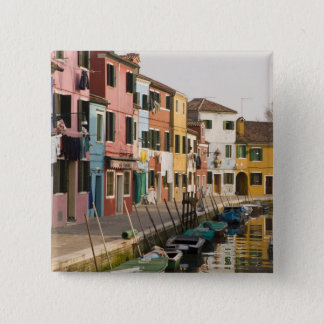 Italy, Burano. Colorful houses of line a Button