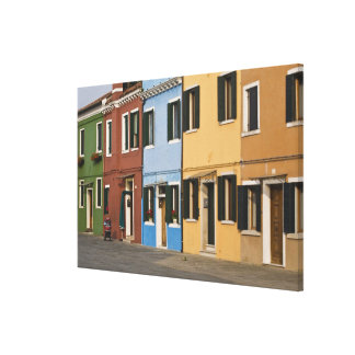 Italy, Burano. Colorful row of homes and empty Canvas Print