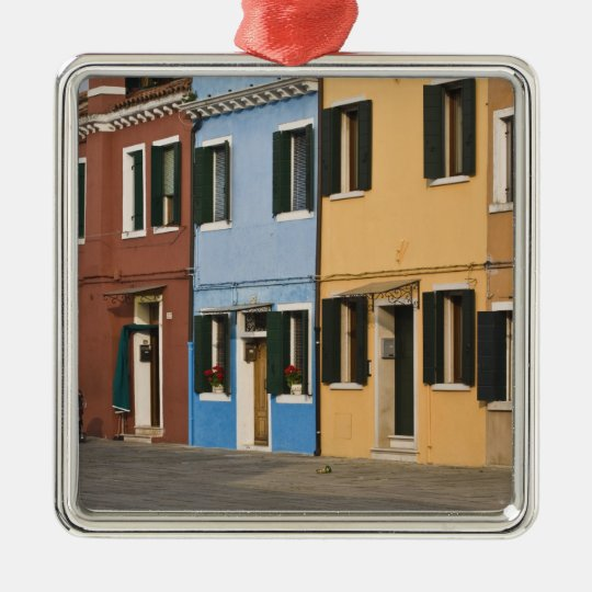 Italy, Burano. Colorful row of homes and empty Metal Ornament