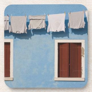 Italy, Burano. Hanging laundry and windows along Coaster