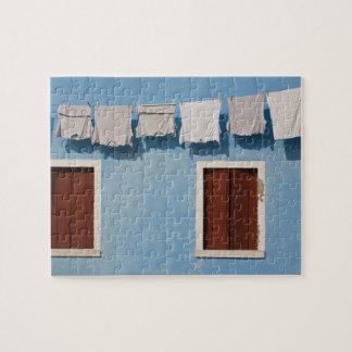 Italy, Burano. Hanging laundry and windows along Jigsaw Puzzle