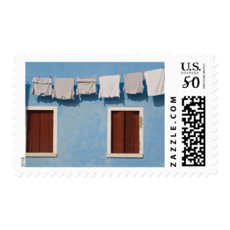 Italy, Burano. Hanging laundry and windows along Postage