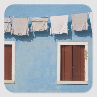 Italy, Burano. Hanging laundry and windows along Square Sticker