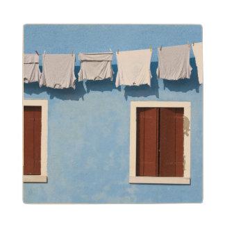 Italy, Burano. Hanging laundry and windows along Wood Coaster