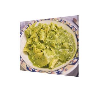 Italy, Camogli. Plate of pasta with pesto Canvas Print