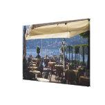 Italy, Como Province, Bellagio. Lakeside cafe. Canvas Print