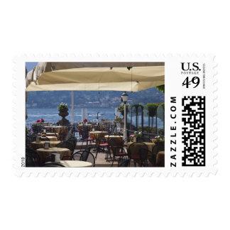 Italy, Como Province, Bellagio. Lakeside cafe. Postage