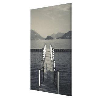 Italy, Como Province, Tremezzo. Lake pier. Canvas Print