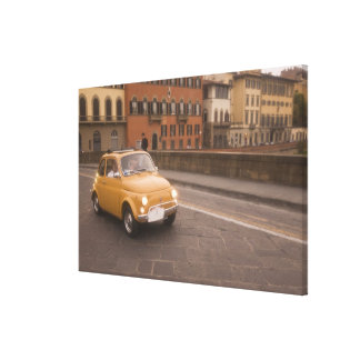 Italy, Florence. Fiat 800 Rally crosses Arno Canvas Print