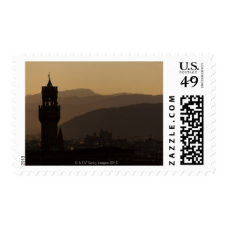 Italy, Florence, Towers in city at dusk Postage