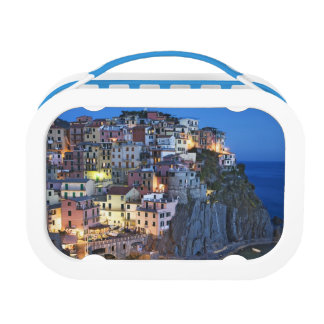Italy, Manarola. Dusk falls on a hillside town Lunch Box
