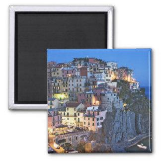Italy, Manarola. Dusk falls on a hillside town Magnet
