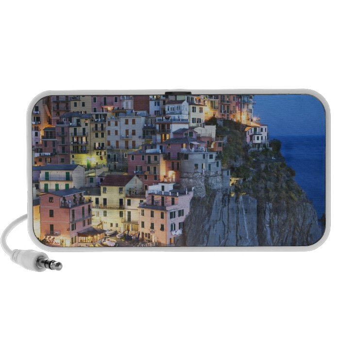 Italy, Manarola. Dusk falls on a hillside town Portable Speaker