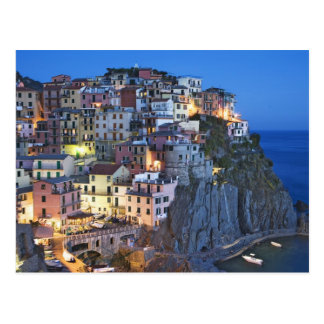 Italy, Manarola. Dusk falls on a hillside town Post Card