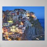 Italy, Manarola. Dusk falls on a hillside town Poster