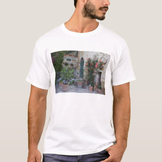 Italy, Petroio. Potted plants decorate a patio T-Shirt