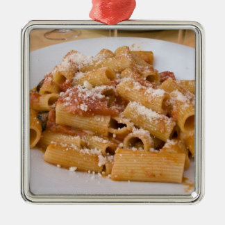 Italy, Positano. Display plate of rigatoni. Metal Ornament