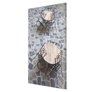 Italy, Sardinia, Castelsardo. Cafe tables. Canvas Print