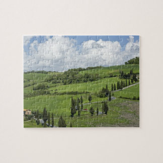 Italy, Tuscany. La Foce. A curved road winds up Jigsaw Puzzles