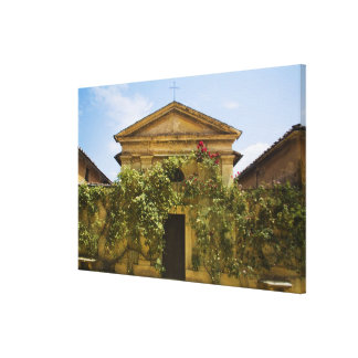 Italy, Tuscany, Old Rose Covered Church in Canvas Print