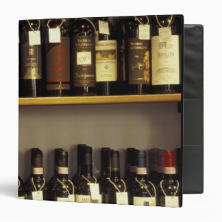 Italy, Tuscany, Pienza Wine display in shop 3 Ring Binder