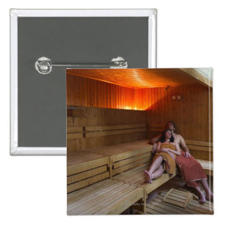 Italy, Tuscany, Young couple relaxing in sauna Button