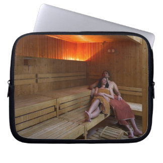 Italy, Tuscany, Young couple relaxing in sauna Computer Sleeve