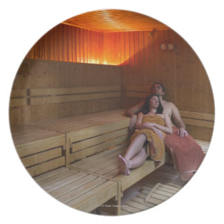 Italy, Tuscany, Young couple relaxing in sauna Melamine Plate