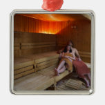 Italy, Tuscany, Young couple relaxing in sauna Square Metal Christmas Ornament