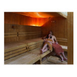 Italy, Tuscany, Young couple relaxing in sauna Post Card
