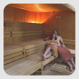 Italy, Tuscany, Young couple relaxing in sauna Square Sticker