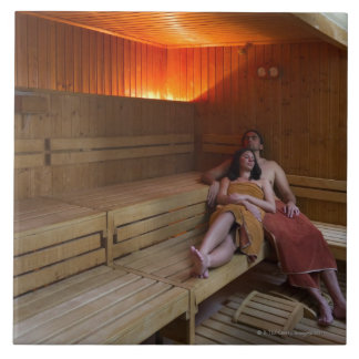 Italy, Tuscany, Young couple relaxing in sauna Tile