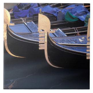 Italy, Veneto, Venice. Row of Gondolas. Tile