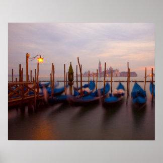 Italy, Venice. Anchored gondolas at twilight. Poster