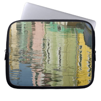 Italy, Venice, Burano. Multicolored houses along Laptop Sleeves