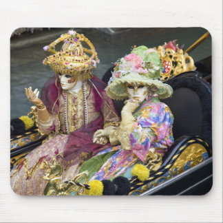Italy, Venice. Couple dressed in costumes for Mouse Pad