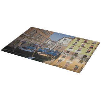 Italy, Venice, gondolas moored along canal Cutting Board