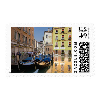 Italy, Venice, gondolas moored along canal Stamps