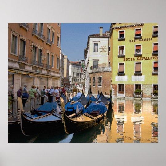 Italy, Venice, gondolas moored along canal Poster