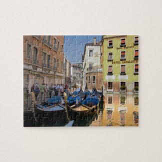 Italy, Venice, gondolas moored along canal Puzzle