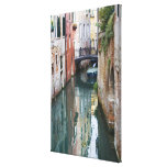 Italy, Venice, Reflections and Small Bridge of Canvas Print