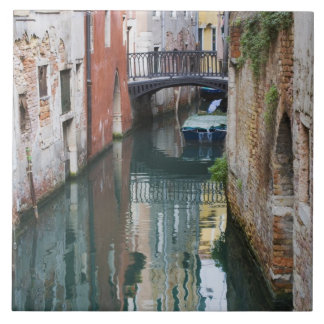 Italy, Venice, Reflections and Small Bridge of Large Square Tile