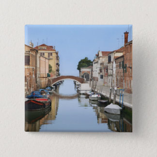 Italy, Venice. View of boats and homes along one Button