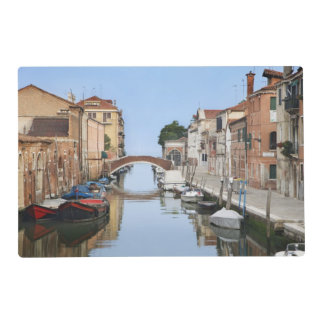 Italy, Venice. View of boats and homes along one Laminated Place Mat