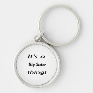 It's a big sister thing! Silver-Colored round keychain