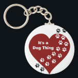"It&#39;s A Dog Thing Heart and Paw Print Key Chain<br><div class=""desc"">As a dog lover,  we know that with a wag of their tail or a furtive look our dogs leave their mark on our hearts. Customize this design by adding your own text or changing the text in the design.</div>"
