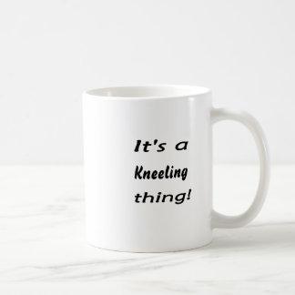 it's a kneeling thing! coffee mug