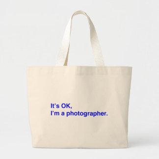 It's OK, I'm a photographer. Large Tote Bag