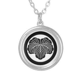 Ivy leaf in circle pendant